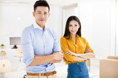 Young business man and woman standing in office Stock Photography