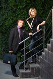 Young business man and woman on the steps Stock Photography