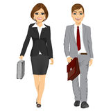 Young business man and woman walking forward Stock Photos