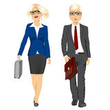 Young business man and woman walking forward Stock Photography