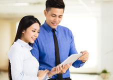 Young business man and woman working in office Royalty Free Stock Images