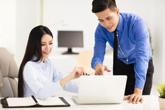 Young business man and woman working in office Stock Photos