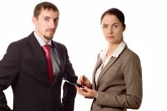Young business man and woman working on a pda royalty free stock image