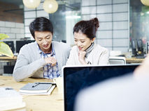 Young business man and woman working together in office Royalty Free Stock Images