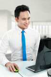 Young business man working Stock Photos