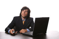 Young business man working with his laptop. And calling on cellphone royalty free stock image