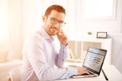 Young business man working at home on his laptop Stock Photos