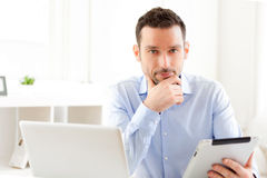 Young business man working at home on his tablet Royalty Free Stock Images