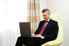 Young business man working at laptop Royalty Free Stock Photo