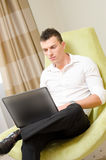 Young business man working at laptop Royalty Free Stock Photos