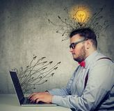 Business man working on laptop has bright ideas Stock Photos