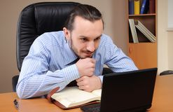 Young business man working in an office Royalty Free Stock Image