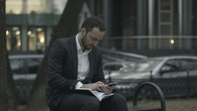 Young business man  working with papers and phone stock footage
