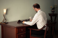Young business man working at table Stock Image
