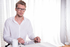 Young business man working on tablet royalty free stock image