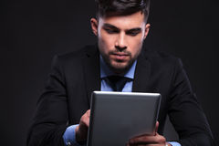 Young business man works on his tablet Royalty Free Stock Photos