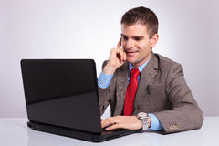 Young business man works on laptop Stock Photos