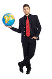 Young business man,World at a Glance. Young business man holding a globe in his hand royalty free stock images