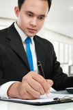 Young business man writing Royalty Free Stock Images