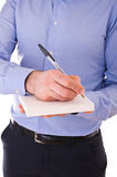 Businessman writing letter. Young business man writing letter Stock Photos