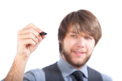 Young business man writing with marker Stock Images