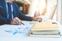 Young business manager working with new startup project. discuss. Ing the charts and graphs showing the results at meeting. Business accounting and financial Stock Photo