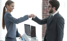 Young business managers show their success Royalty Free Stock Image