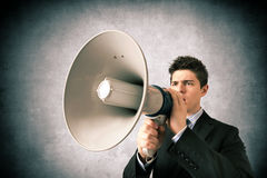 Young business with a megaphone royalty free stock images