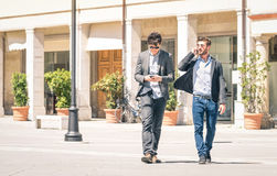 Young business men in the city main square with smartphone Stock Photography