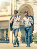 Young business men in the city main square with smartphone Royalty Free Stock Photo