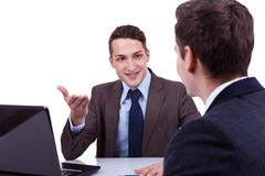 Young business men having a discussion stock photo