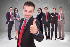 My team is ok!. Young business men leader of a successful team making the thumbs up ok gesture royalty free stock image