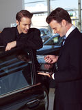 Young business men out side of office Royalty Free Stock Images