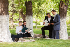 Young business men and women in a city park Royalty Free Stock Photos