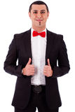 Young business model posing by adjusting his coat Stock Images