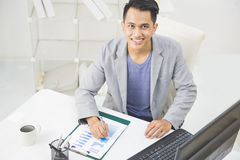 Young business owner at his office Royalty Free Stock Images