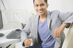 Young business owner at his office Stock Photos