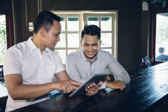 Young business owner and team partner with tablet in cafe Stock Photography
