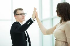 Young business partners giving each other high five. The concept of a startup royalty free stock photo