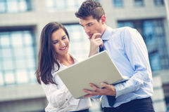 Young Business Partners With laptop Stock Photography