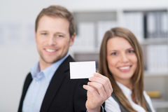Young business partners presenting a blank card Stock Image