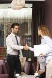 Young business partners shaking hands Royalty Free Stock Photo