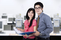 Young business partners at workplace Stock Photography