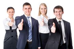 Young business people. Portrait of confident young business people with thumbs up sign Stock Photo