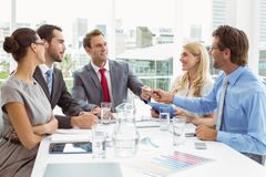 Young business people in board room meeting. At the office Royalty Free Stock Images