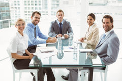 Young business people in board room meeting Stock Photo