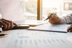 Young business people calculate summary finance in the office at. Work royalty free stock images