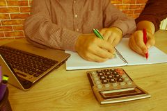 Young Business people Calculating Finance Bills In Office Royalty Free Stock Photography