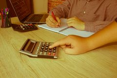 Young Business people Calculating Finance Bills In Office Royalty Free Stock Images