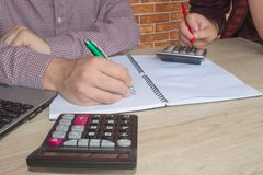 Young Business people Calculating Finance Bills In Office Royalty Free Stock Photos